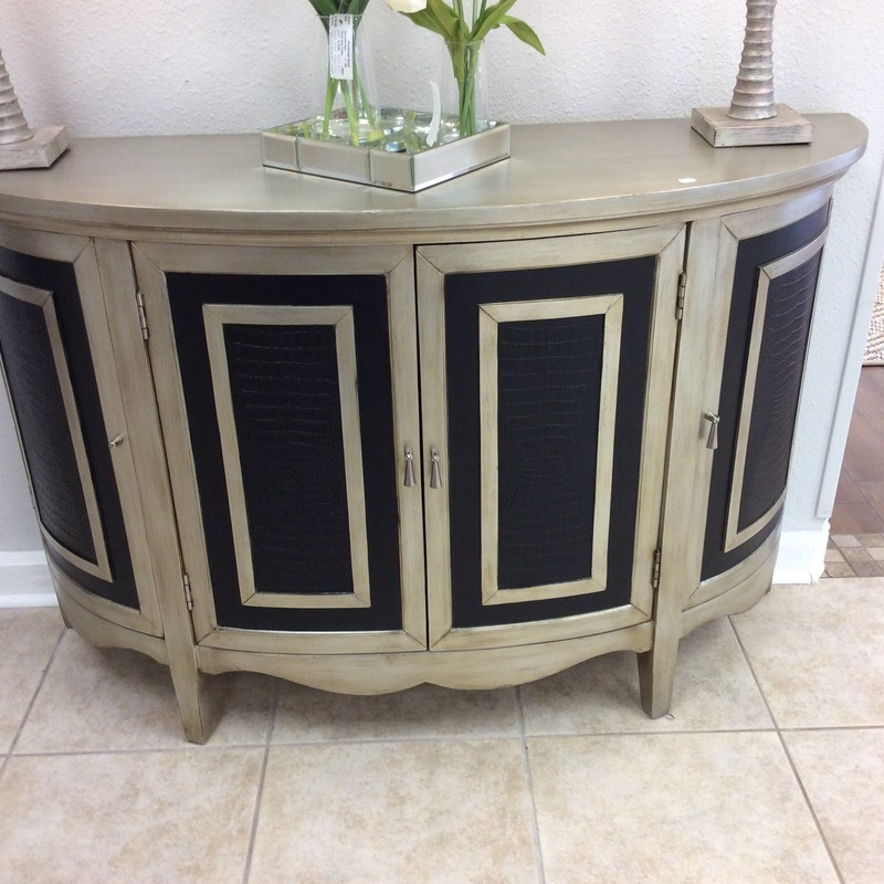 This sure is a pretty little piece. It is a PULASKI and appears to be solid wood with an antiqued silver and matte black painted finish. There are faux alligator skin inlays on the fronts of all 4 doors. The center lower cabinet has a drawer and lots of storage space, while the 2 side cabinets arequite small, and each has a single shelf.