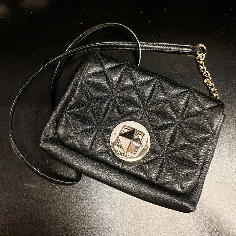 Beautiful Kate Spade Small Purse.<br /> - 100% black cow leather exterior<br /> - Turn-lock closure<br /> - Shoulder strap with 20 in. drop and chains<br /> - Interior features: 100% polyester lining, one slip pockets<br /> - W: 8.5 in. H: 6.5 in. D: 1.75 in.<br /> <br /> * Please note that these measurements and pictures are for reference only and may vary slightly from the original.