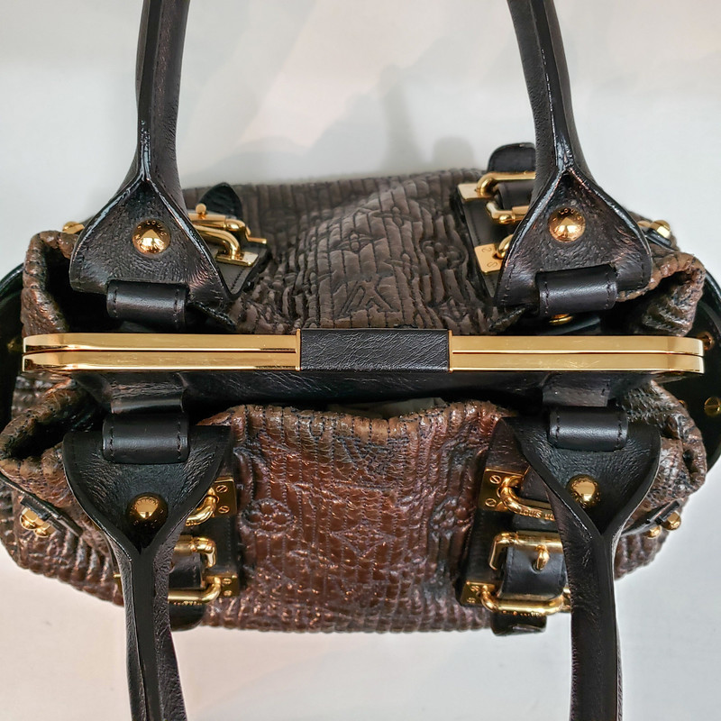 "Louis Vuitton<br /> Motard Biker Bag<br /> Limited Edition<br /> Brown and Black with Gold Hardware<br /> Original Retail over $4000<br /> Handle Drop: 6.5""<br /> Height: 9.5""<br /> Width: 14""<br /> Depth: 5.25"""