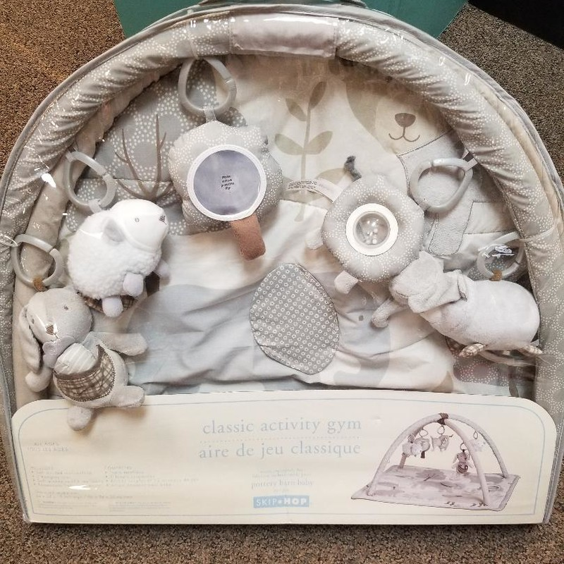 NEW Classic Activity Gym for baby<br /> Exclusive for Pottery Barn Baby<br /> Made by Skip Hop<br /> Gender neutral<br /> Retails for $89.00<br /> NO SHIPPING, STORE PICKUP ONLY