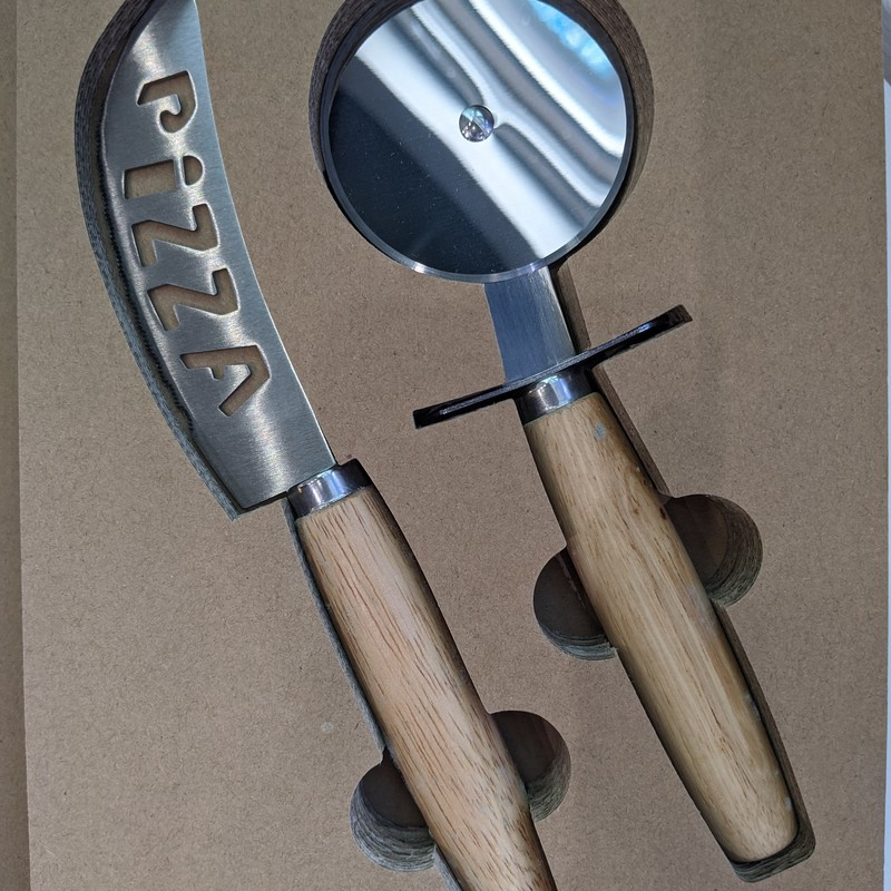 A great gift for any occassion. The packaging on this product is so cute! Made to look like a book tied with string. Set includes a round pizza cutter and a french pizza knife.<br /> Featured at Be Kind Creative Designs