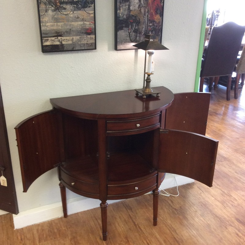 Beautiful! Casual but elegant styling is this half moon table by Uttermost. It features a dark wood finish, 6 drawers - 2 real and 4 faux. Three spacious cubbies for storage with vintagy brushed hardware. Nice fresh twist on the classic half-moon!