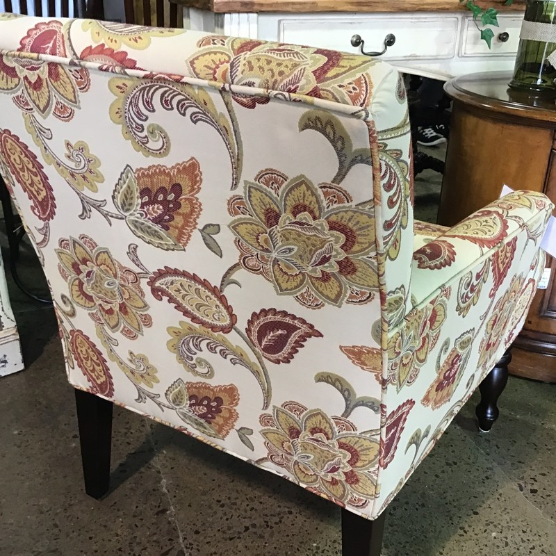 "Very comfortable wingchair by Pier 1.  Featuring a beautiful fabric with multi colors including reds, greens, yellows and rusty oranges, this chair will compliment any decor.  There is a matching chair # 6609.<br /> <br /> Dimensions:  29"" x 34"" x 35"""