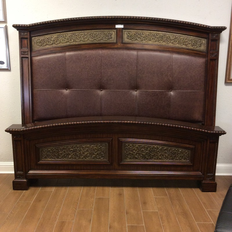 This king-size bed from Maitland Smith is a gorgeous combination of wood and leather!  Maitland Smith is synonomous with luxury and this bed is certainly that! This headboard and footboard include beautiful inlaid marquetry, the finest hand-carved woodwork and embossed leather. Rails included.