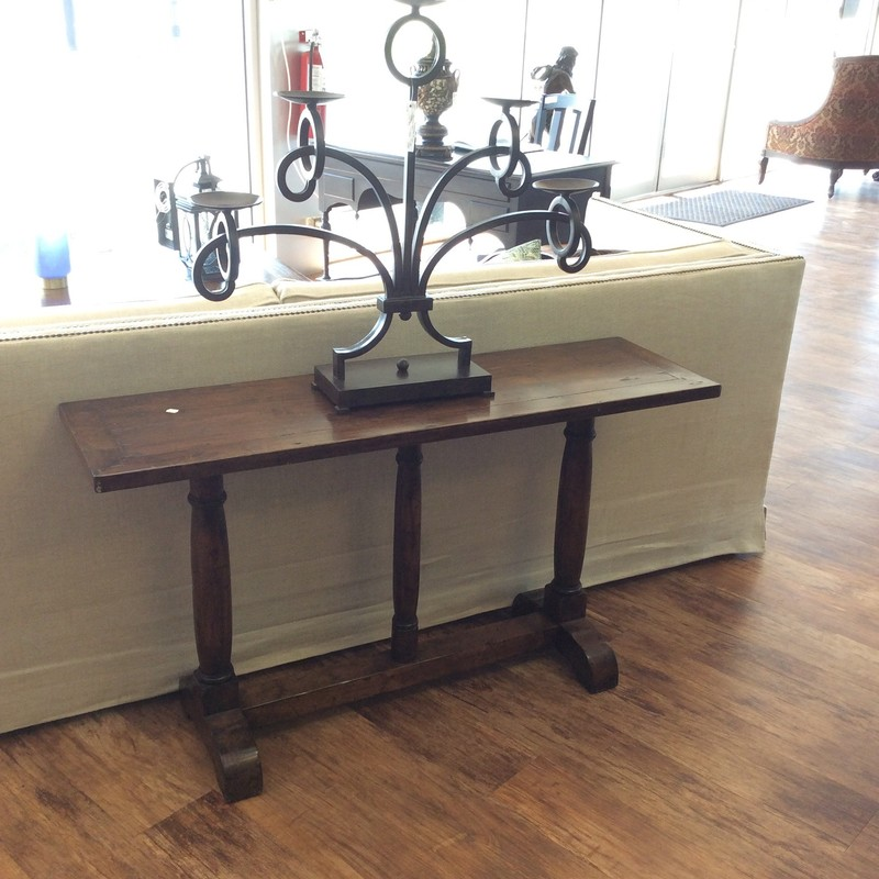 This sofa table is lovely!  A little smaller in scale than most sofa tables, it's the perfect accessory piece for a smaller space. It features a rough-hewn tabletop top in a dark wood finish that's so popular giving it that distressed, timeworn look. Great condition.