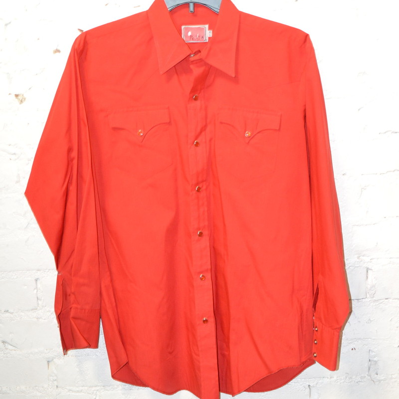 -Pearl Snap<br /> -Red<br /> -Has pockets<br /> -Size large