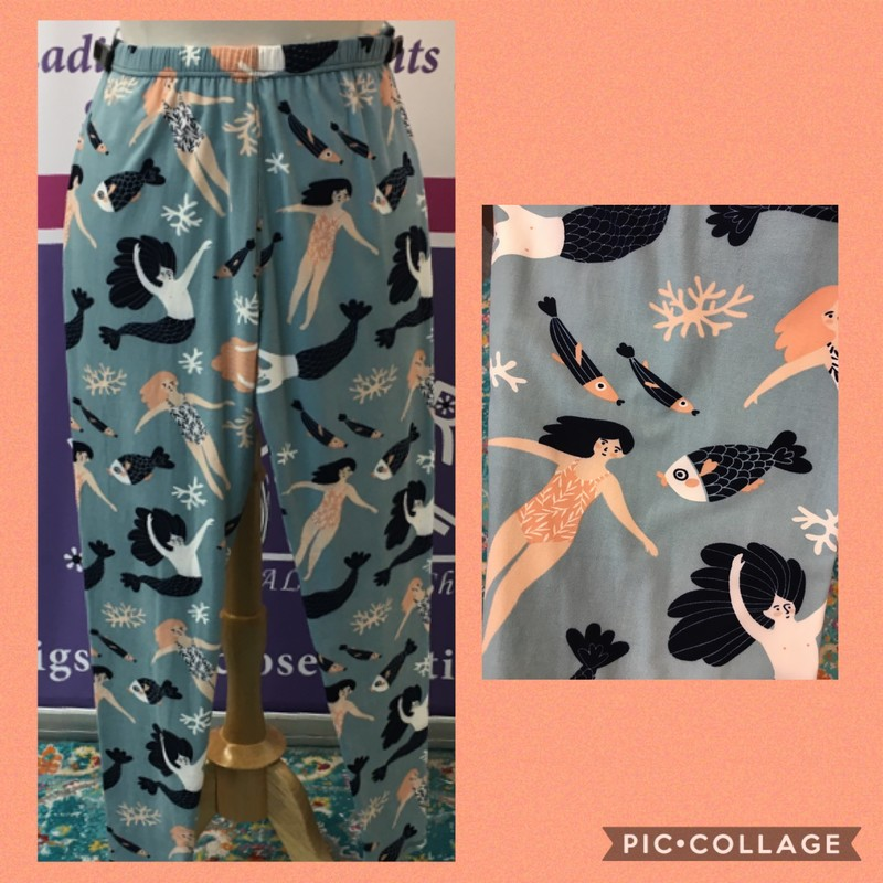 These funky leggings feature mermaids, fish, and coral pieces.  Light blue background, and navy, peach, and white in the print.<br /> Size: One Size (14-20)<br /> 92% Polyester 8% Spandex