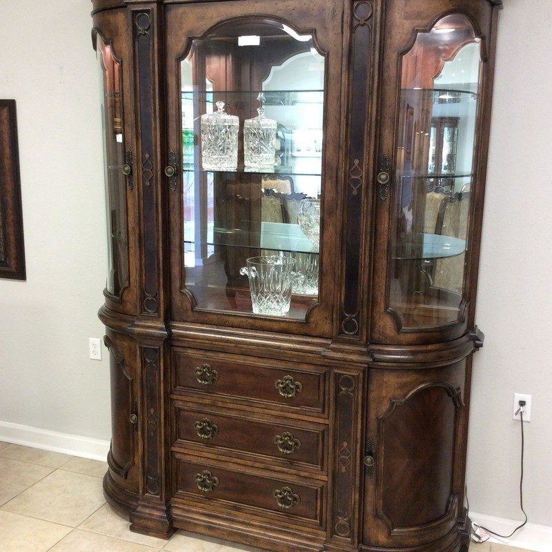 This is a gorgeous china cabinet! It is a BERNHARDT and the consignor originally paid $4400 for it. It is actually 2 pieces, the bottom of which has 3 roomy drawers with dovetailed jointing (and the top one is lined for flatware). The 2 side cabinets each have a single shelf. The upper piece has 3 wood/glass doors, behind each of which are 3 adjustable glass shelves. ONLY $1495. Best of all, though, there is a matching dining table with 8 chairs that is available for purchase seperately.