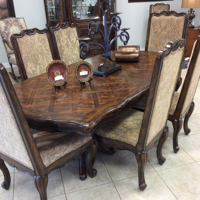 This is a GORGEOUS dining set! There is also a beautiful china cabinet that came in with it, and we have priced seperately. The entire BERNHARDT set is solid walnut and has burled walnut accents on the parquet top. The parquet pattern is called Versailles, and it is lovely! When the two 19 inch leaves are inserted, this table measures more than 10 feet long! The 8 chairs, 2 of which have arms, are all in fabulous condition, too. The original price was $4500, but you can own it today for only $1495!