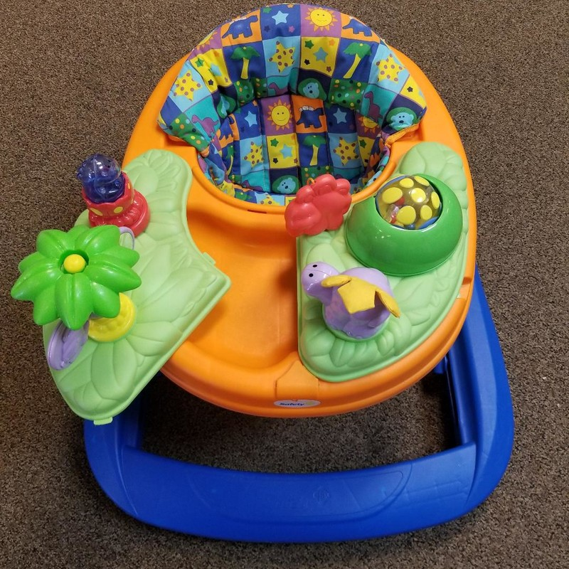 Safety 1st Dino Walker<br /> Both side of tray open<br /> Folds down for storage<br /> More info found online<br /> Retail $50.00<br /> NO SHIPPING, STORE PICKUP ONLY