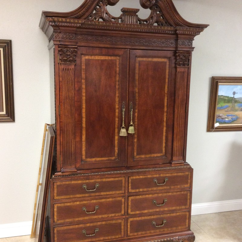 This is a really pretty armoire from UNIVERSAL FURNITURE. The consignor oiginally purchased this piece at LAURIE'S in Tomball. It is solid wood with a two-toned walnut finish and the carved details are exquisite. Up top, there are removable/adjustable shelves, as well as a single drawer and a clothing bar. There is also electrical and cut-outs in the back for a television and other electronics. Down below there are 6 roomy drawers. ONLY $595!!