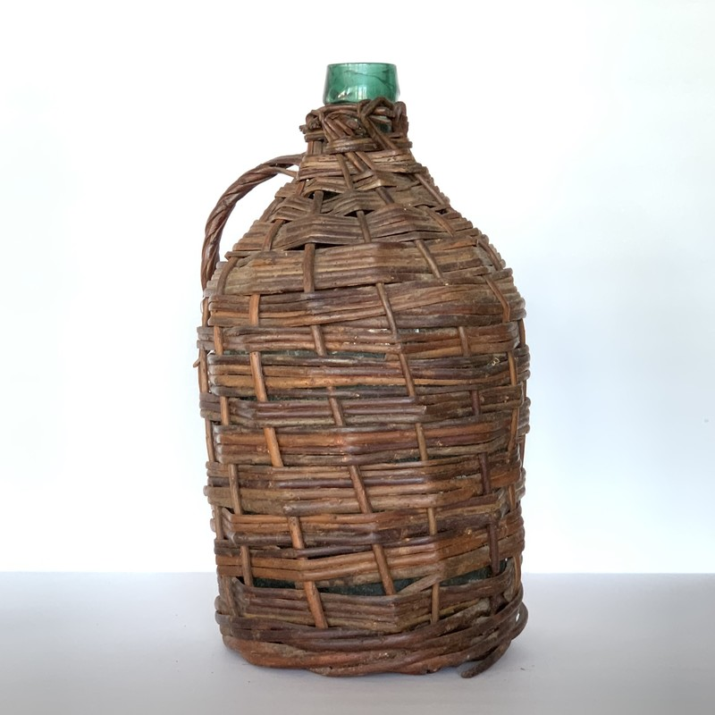 This wicker-wrapped bottle displays natural Elements. Air in the bottle, Earth surrounding it, and Water when it is used. Let's just hope there's no Fire though. . . perhaps a candle would be more appropriate for that Element!