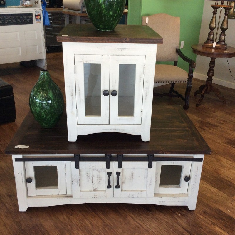 "Here is more of the rustic table/cabinet set that came in this week. These 2 pieces include a 50""x31""x20"" coffee table that has faux barn doors, as well as 2 glass-doored cabinets on BOTH SIDES OF THE TABLE. The side table/cabinet measures 23""x24""x26"" and has 2 paned-glass doors. Both pieces have dark brown tops, with a rough hewn finish, and rustic painted white bases."