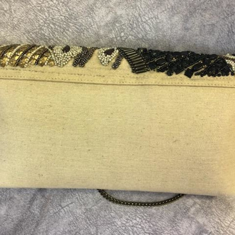 CHICOS, Beaded, Size: Clutch<br /> This CHICOS purse can be used over the shoulder or as a clutch.<br /> Its is 100% cotton and the front flap is fully beaded in black, gold, tan, brown and white.<br /> Light weight and a greta statement piece to any outfit.