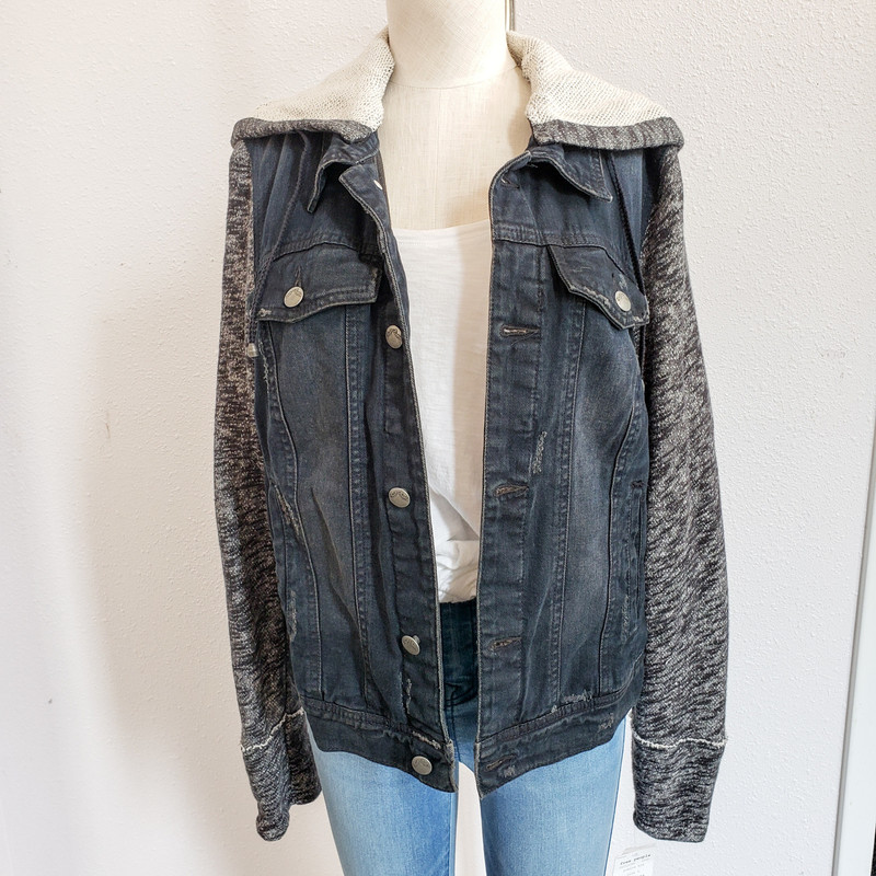 Free People<br /> Denim Jacket with built in hoodie and sweatshirt sleeves<br /> Size L<br /> NWT<br /> Original Retail $148