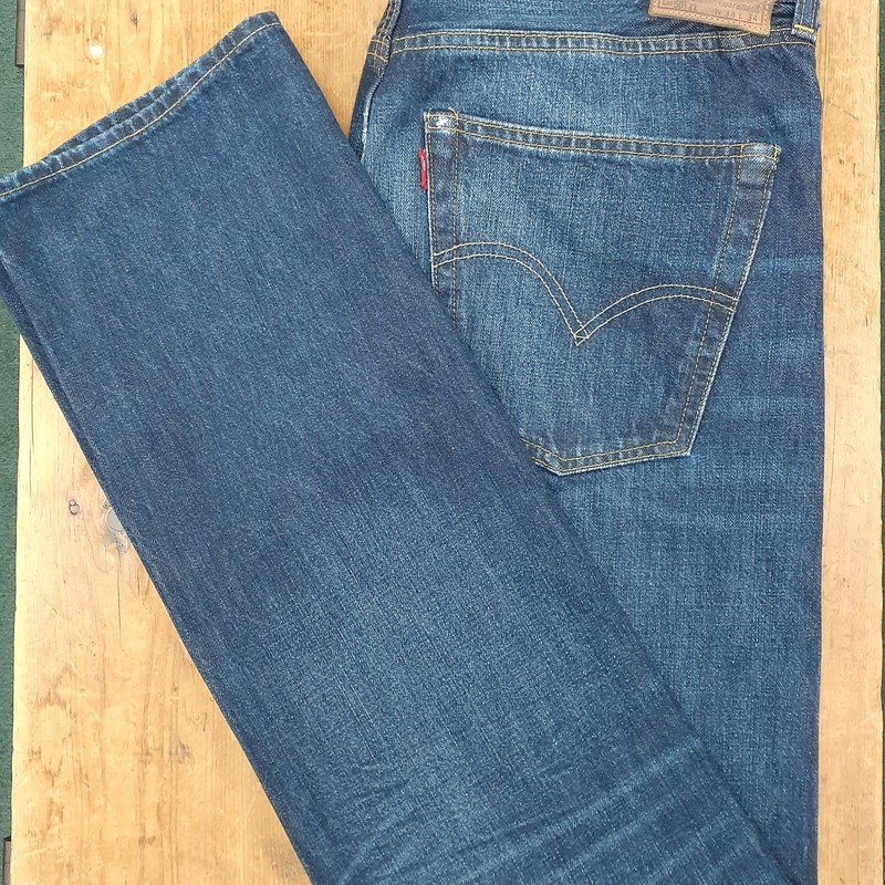 "Premium Levis w/ button fly<br /> Color: Denim<br /> Size: 34W 35L; Tag says 34"" length, but legs measure around 35""-36""<br /> Condition: Excellent, some wear on back pockey corners"