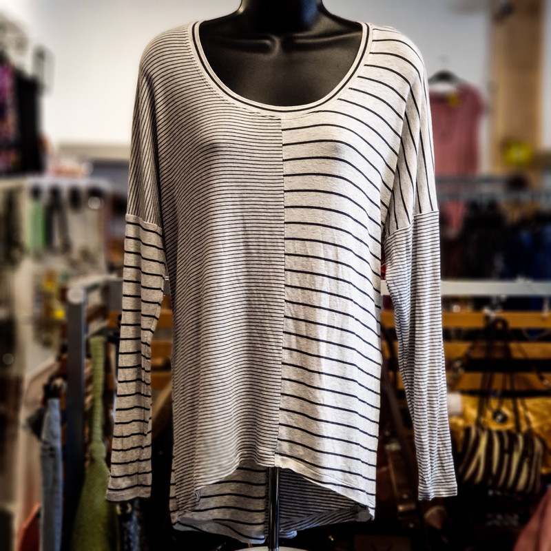 Beautiful Cabi Top.<br /> - Light gray and dark gray color<br /> - Striped design<br /> - Stretchy<br /> - Bust circumference: 46 in.<br /> - Length: 25 in.<br /> - Sleeves length: 25 in.<br /> - Size Small<br /> <br /> * Please note that these measurements and pictures are for reference only and may vary slightly from the original.