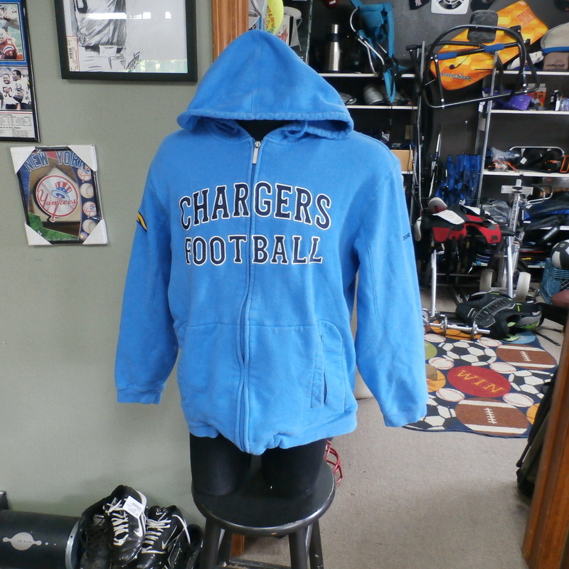 San Diego Chargers Hoodie Blue size Small #22283<br /> Our Clothes Rating: 3- Good Condition<br /> Brand: Reebok<br /> size: Men&#039;s Small (Chest: 22&quot; Length: 25&quot;)<br /> color: Powder Blue<br /> Style: zip up hoodie; embroidered logos<br /> Condition: 3- Good- slightly worn and faded; light pilling and fuzz; noticeable light pilling across the lower front; sleeve ends are worn from use; material is slightly stretched out at the bottom;<br /> Shipping: FREE<br /> Item #: 22283
