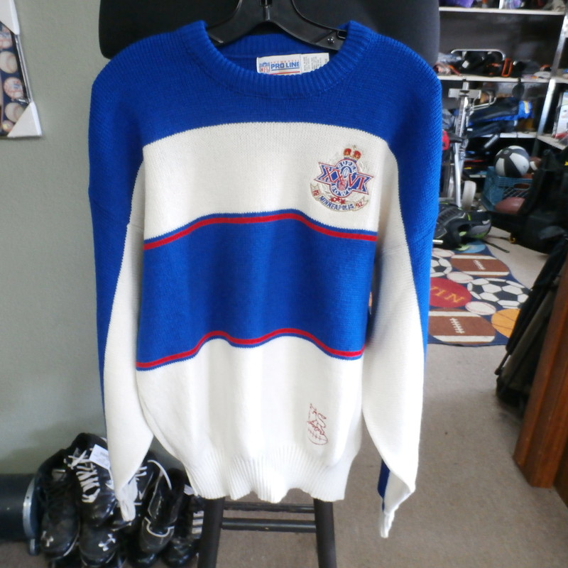 "Title: Super Bowl XXVI Men's sweater blue size Large #22322<br /> Our Clothes Rating: 3- Good Condition<br /> Brand: Pro Line<br /> size: Men's Large- (Chest: 24"" Length: 27"")<br /> color: White/ Blue<br /> Style: Knit Sweater; embroidered logo; crew neck; 75% Orlon, 25% wool<br /> Condition: 3- Good- slightly worn and faded; medium pilling and fuzz; material is slightly stretched out from washing and use; fuzz on the fabric<br /> Shipping: FREE<br /> Item #: 22322"