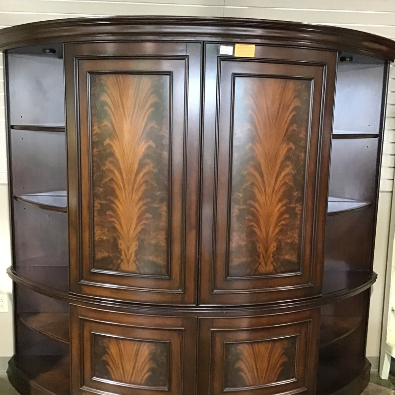 "Are you looking for an entertainment center to hide your television when not viewing? This piece is absolutely beautiful! It has sliding doors on both the top and bottom which can hide your tv and only show the ""pretty items"" you have displayed on the sides. When you want to watch TV, just slide the doors over! The inside cabinet for the television is 50"" wide, which should hold up to a 56"" television. The bottom and top shelving are perfect for all of your components. The beautiful ""flame"" accent on the top gives this piece tons of character! Also, there are lights on either end (controlled by 1 switch) and the center also has lights.<br /> Dimensions are 91"" x 28"" x 82"""