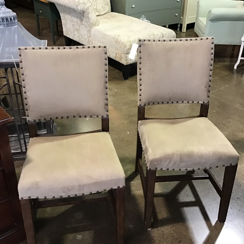 "Are you looking to update your dining space? Do you need a couple of accent chairs for a bedroom or family room? Look no further than these beautiful everyday suede dining chairs from Pottery Barn. They are from the Manchester Collection and are upholstered in a Light Wheat Everyday Suede fabric and have nail trim accents. We have a total of 10 of these in stock (5 sets of 2), so if you need to update your entire dining room, we've got you covered!<br /> Dimensions are 18"" x 18"" x 36""."