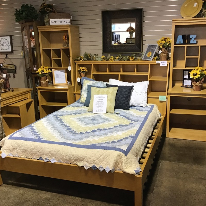 "This Pottery Barn bedroom set has a storage headboard (lots of cubbies!) and two side pieces that also have plenty of storage! This set comes with the headboard, footboard, side rails & slats plus 2 side units that are 2 pieces. Perfect for your child's bedroom! We also have a matching desk with rolling cart in stock as well (sold separately, item #101649).<br /> Bed Dimensions are 66"" x 98"" x 48""<br /> Side Pieces Dimensions are 24-1/2"" x 24"" x 72"""