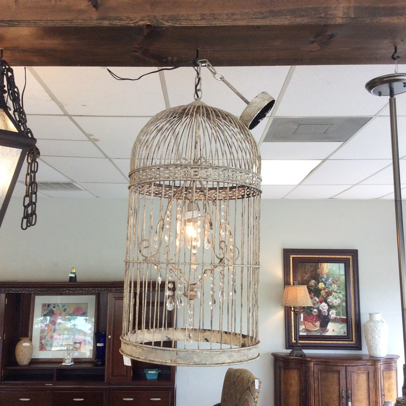 This hanging light fixture was made from an old birdcage. It has a single light that takes a candelabra bulb. There are dangling crystals to help reflect the light. ONLY $175!