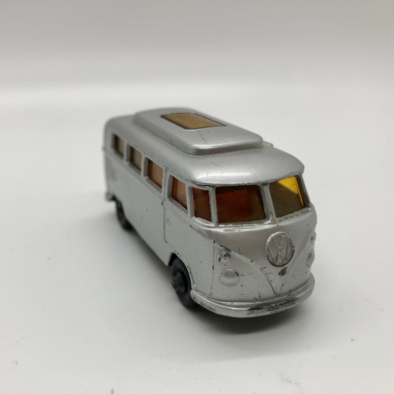 Vintage Matchbox Lesney Volkswagen Camper #34, Silver With An Orange Interior. The doors on this c.1967  diecast open! In really clean used condition.<br /> Will be shipped priority mail or can be picked up.