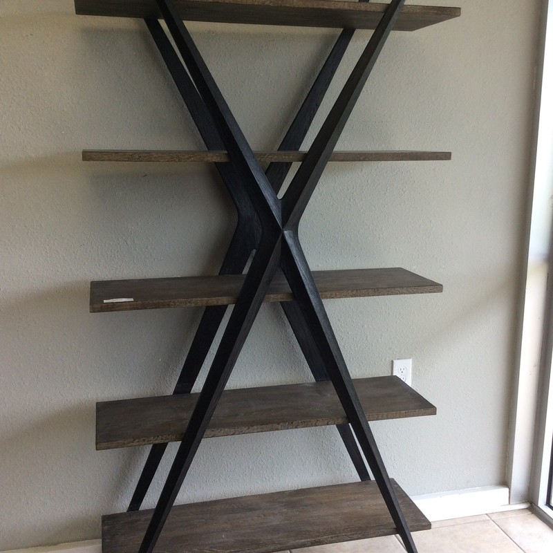 "Bookcases can be soooo boring, but not this one!! This smart looking piece is by XANDER and originally cost $1700 brand new. It appears to be solid wood and the shelves have a driftwood colored finish. The ""X"" accents on the front and the back both have a soft black finish. Best of all, though, there is a matching twin that is available for purchase seperately."