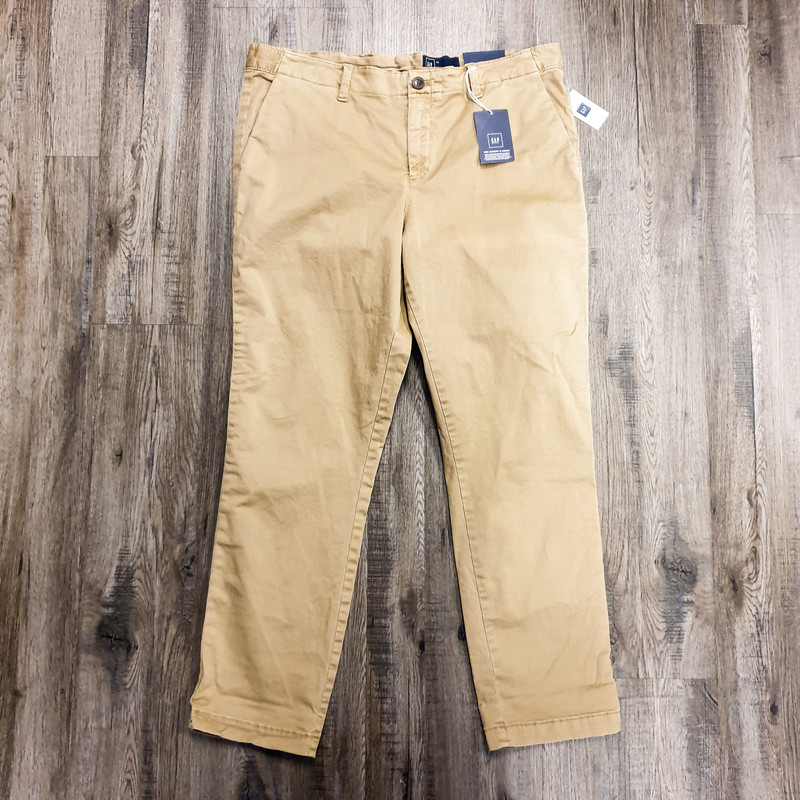 "Beautiful Gap Pants.<br /> - Brand new<br /> - ""Girlfriend Chico"" style<br /> - Tan color<br /> - Real front and back pockets<br /> - Mid-rise<br /> - Stretchy<br /> - Waist circumference: 36 in.<br /> - Length: 37.5 in.<br /> - Size Large/14<br /> <br /> * Please note that these measurements and pictures are for reference only and may vary slightly from the original."