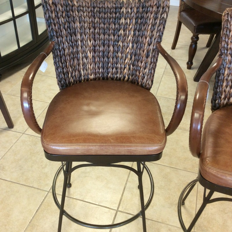 BARGAIN ALERT!!!! This handsome trio of bar chairs is only $695! When you consider they were originally purchased for $600 EACH, $695 is a steal for all three. The solid iron bases have a smart looking burnished bronze finish. The seats and arms are covered in top grade leather, and the backs are covered in woven sea grass.