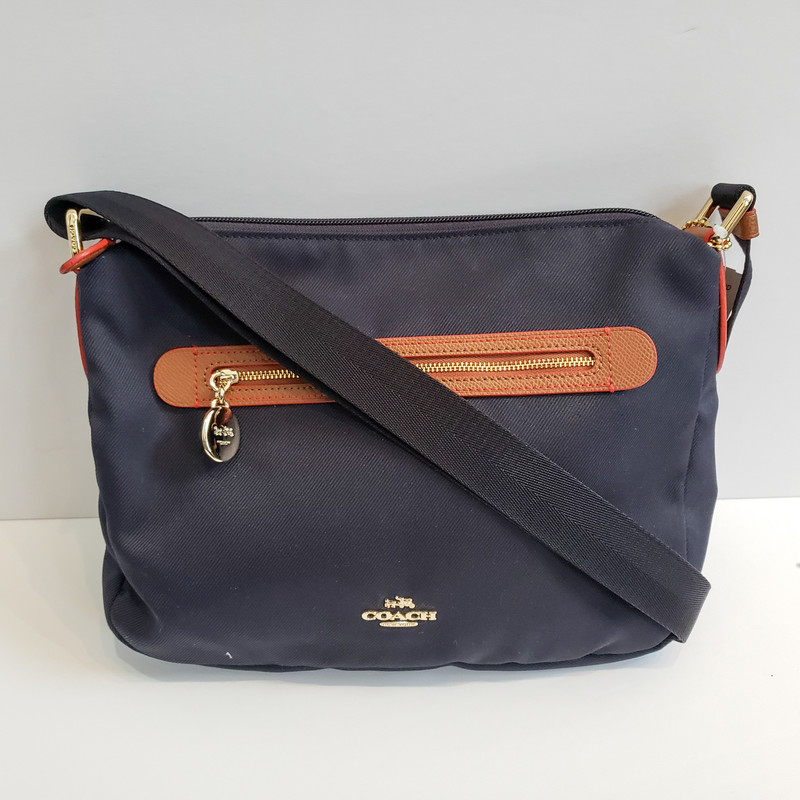 Coach<br /> Navy Nylon with Brown Trim and Gold Hardware<br /> Original Retail $195<br /> NWT