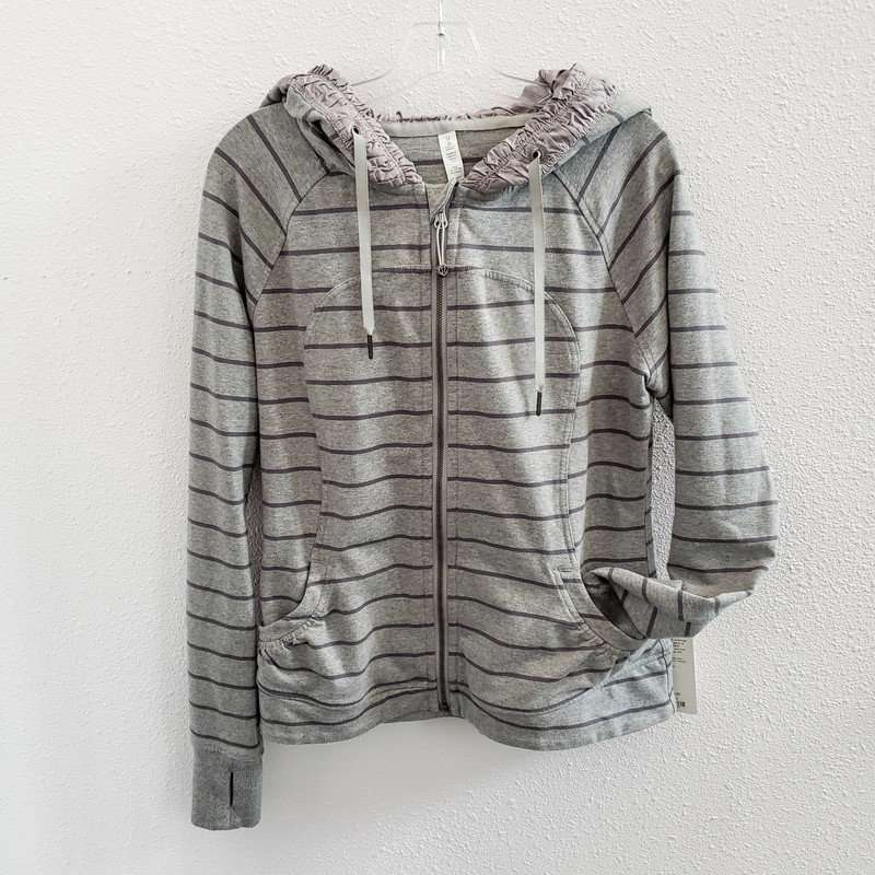 Lululemon<br /> The Movement Jacket<br /> Gray Stripe Hoodie<br /> Size 12<br /> NWT<br /> Original Retail $108