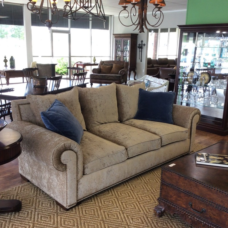 This sofa by Massoud is stunning! Thinking about adding a little glam to your room? This sofa could do it. Massoud is dedicated to providing the highest quality furniture as this sofa will attest to. It lives large and deep. It's upholstered in a champagne velveteen that is just delish - so soft and kinda of vintagy and definitely glamorous! It features large rolled arms and a big, bold nailhead trim. Super comfortable and in excellent condition. Come by soon and take a look!!