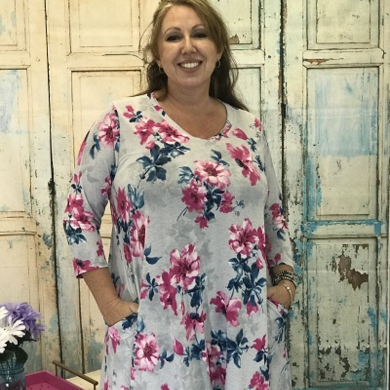 Beautiful pinks and blues on a gray background!<br /> Has Pockets<br /> 3/4 length sleeves<br /> 95%polyester/5%spandex<br /> 36&quot; length