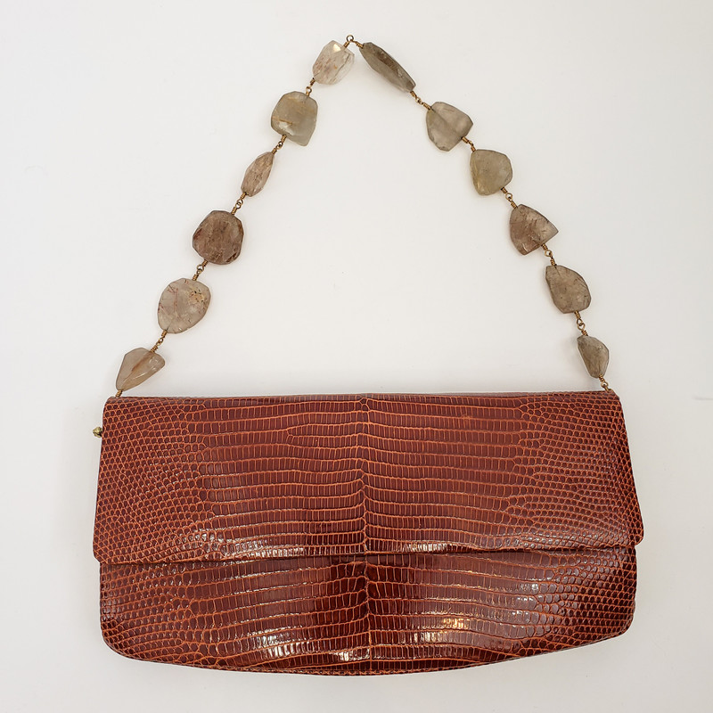 Darby Scott<br /> Alligator Necklace Bag<br /> Removable strap can be worn as a necklace<br /> Retails for over $5000