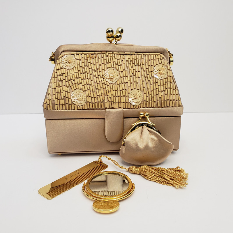 Judith Leiber<br /> MINT Condition<br /> Champagne Satin and Beads<br /> Comes with Dustbag<br /> Gold Comb<br /> Small Coinpurse<br /> Gold Mirror<br /> Removable cord so it can be a clutch or shoulder bag