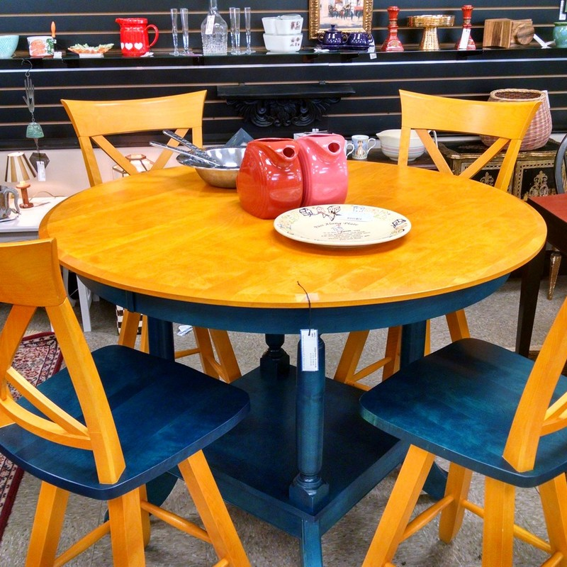 All wood constructed Canadel set with 4 swivel chairs and round pub height table. Check out that quirky color combination of orange and teal!