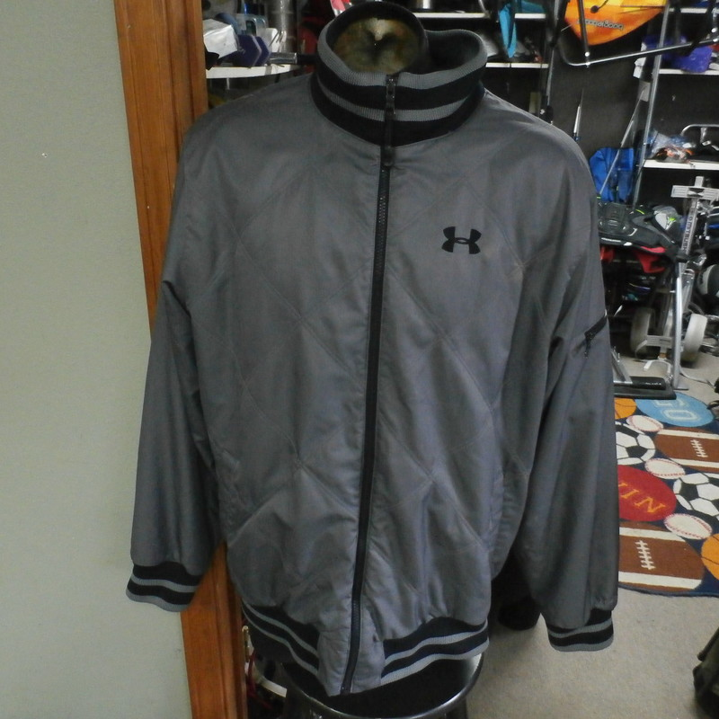 Under Armour Storm zip-up jacket gray size XL polyester #21932<br /> Rating: (see below) 3- Good Condition<br /> Team: n/a<br /> Player: n/a<br /> Brand: Under Armour<br /> Size : Men&#039;s XLarge- (Measures Chest 26&quot; ; Length 30&quot;) armpit to armpit; shoulder to hem<br /> Color: gray<br /> Style: zip-up; embroidered<br /> Material: 100% polyester<br /> Condition: 3- Good Condition; wrinkled; material is stretched and worn from wearing and washing; some pilling and fuzz; some fading and discoloration; no rips or tears; material feels good; zipper pull appears to have been chewed on; there are bleach marks around the UA logo on the front; two smaller bleach marks on middle of back  (see photos)<br /> Item #: 21932<br /> Shipping: FREE