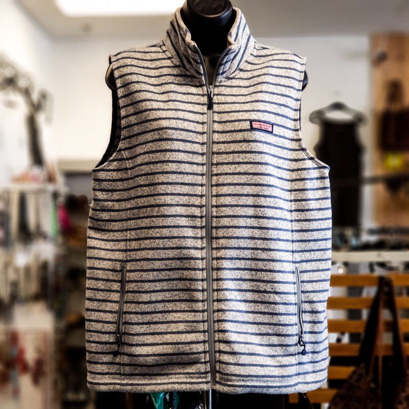 Beautiful Vineyard Vines Vest.<br /> - Light gray and blue color<br /> - Striped design<br /> - Real front zipper<br /> - Real front pockets<br /> - Stretchy<br /> - Sleeveless<br /> - Bust circumference: 42 in.<br /> - Length: 28 in.<br /> - Size Large<br /> <br /> * Please note that these measurements and pictures are for reference only and may vary slightly from the original.