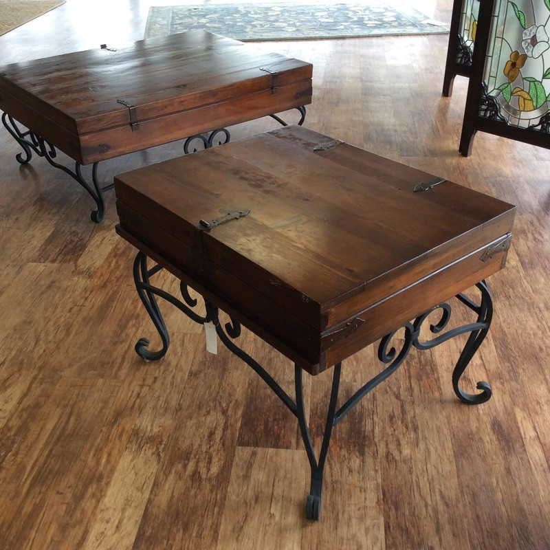 This handsome side table also has a matching coffee table, that is available for purchase seperately. This table features a solid wood top with a mahogany finish and faux hinges, as well as other metal details. The base is scrolled iron with a matte black finish. Only $195!