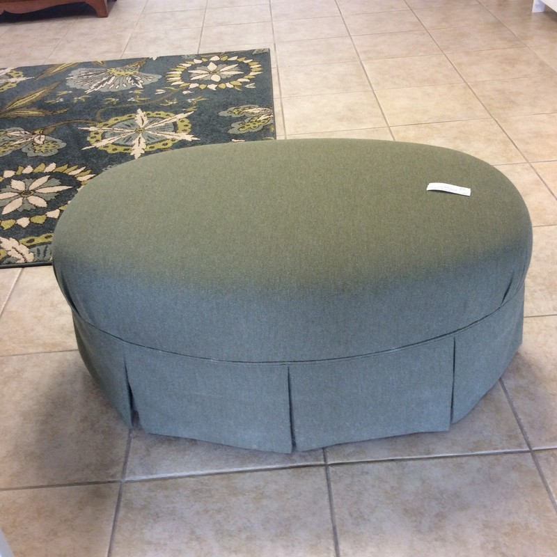 BARGAIN ALERT!!! Since it's made by BROYHILL, you know this is a high quality piece. This ottoman is on 4 casters, so very wasy to move around. It is oval shaped and has a pretty tightly woven olive/taupe upholstery. ONLY $125!!