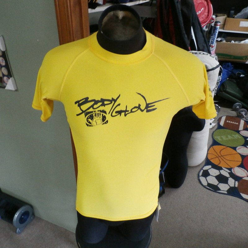 Body Glove boy&#039;s swim shirt yellow size 16 polyester #22941<br /> <br /> Rating: (see below) 3- Good Condition<br /> <br /> Team: n/a<br /> <br /> Player:  n/a<br /> <br /> Brand: Body Glove<br /> <br /> Size : Boy&#039;s size 16- ( Measures Chest 18&quot; ; Length 24&quot;) armpit to armpit; shoulder to hem<br /> <br /> Color: yellow<br /> <br /> Style: short sleeve; screen printed<br /> <br /> Material: 85% polyester 15% spandex<br /> <br /> Condition: 3- Good Condition;  wrinkled; some pilling and fuzz; material is worn from wearing and washing; some fading and discoloration; no rips or tears; some small snags; 3 light stains on left side; small light stain on right back shoulder (see photos)<br /> <br /> Item #: 22941<br /> <br /> Shipping: FREE