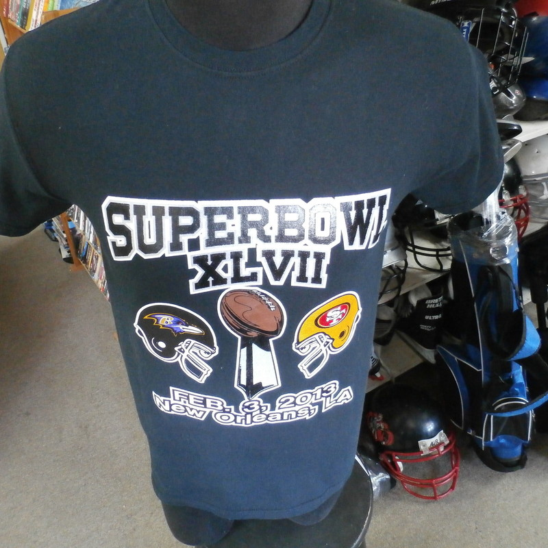 "Super Bowl XLVII T-shirt Ravens vs. 49ers Black Gildan size small #22744<br /> Rating: (see below) 3- Good Condition<br /> Team: Baltimore Ravens vs. San Francisco 49ers<br /> Player: n/a<br /> Brand: Gildan<br /> Size: Small- men's (Measured Flat: chest 17"", length 27"")<br /> Color: Black<br /> Style: short sleeves; screen printed<br /> Material: 100% Cotton<br /> Condition: 3- Good Condition - some pilling and fuzz; some fading and discoloration; wrinkles; some stretching and wear from washing and wearing; screen printing looks fresh and new; no rips or tears; no stains (see photos)<br /> Shipping: FREE<br /> Item #: 22744"