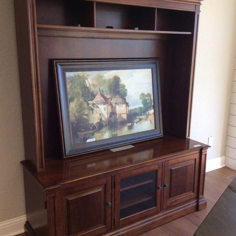 This handsome EA entertainment/media cabinet was originally purchased directly from ETHAN ALLEN years ago. It is 2 pieces, and features solid wood construction with a pretty cherry finish. There is ample storage below, and the 3 doors have both glass and wood inserts, depending on what you choose. ONLY $795!