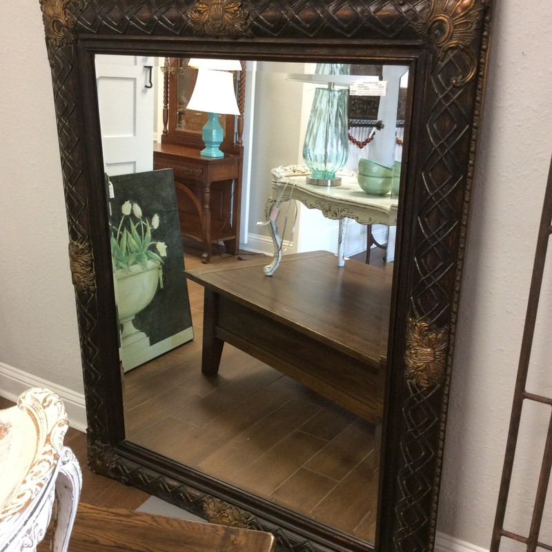 This nice, large mirror is very lovely, and quite heavy! There is no hanging harware on the back, so this mirror is intended to be a leaner. The mirror itself is beveled, and the black/bronze frame has handsome gold carved details. Stop by and see this piece for yourself. ONLY $395!