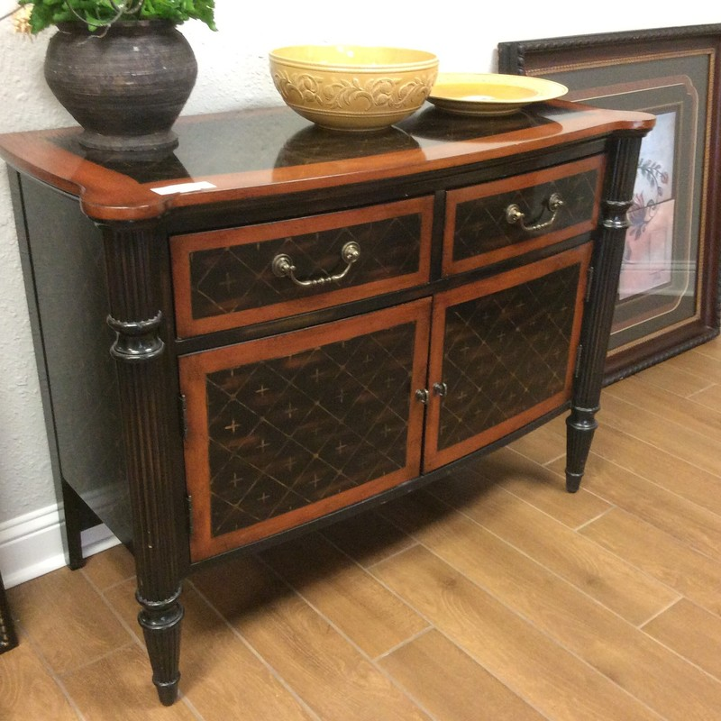 This adorable painted cabinet is by HOOKER and is in fabulous condition. It is solid wood and has a pretty stained black and brown finish. There are 2 small drawers up top and a roomy cabinet with a single adjustable shelf down below. ONLY $395!