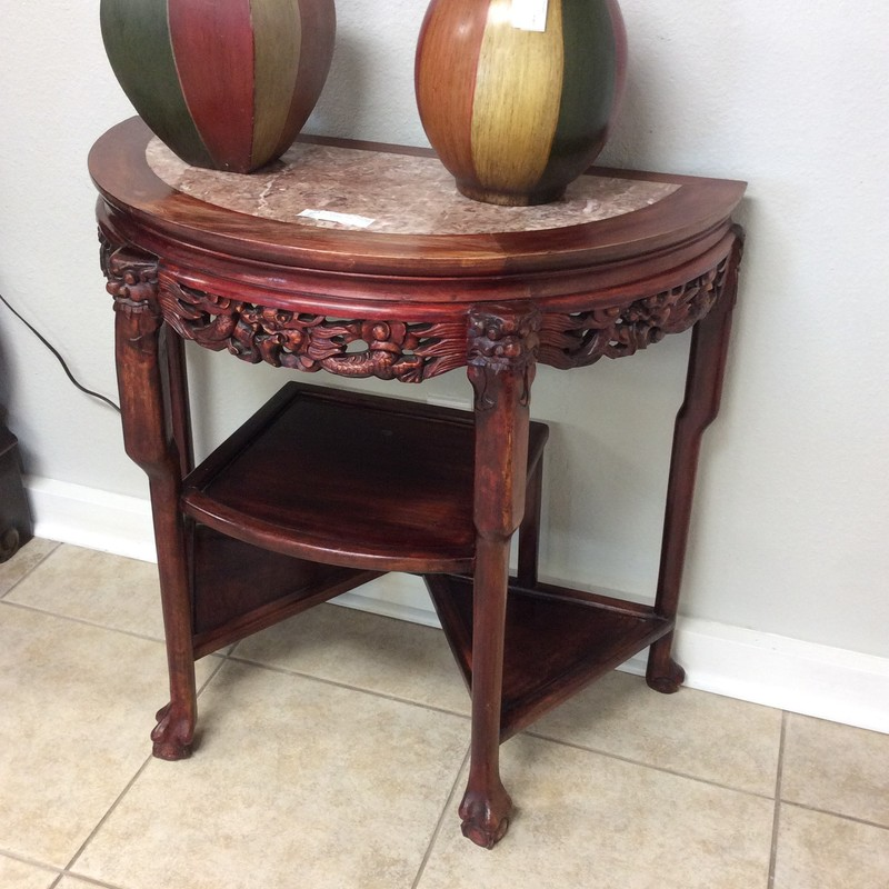BARGAIN ALERT!!! This cute little entryway table is priced to move at only $125! It is solid wood and has an almost cherry red stained finish. There are lots of fancy carved details, as well as 3 small lower shelves. The top is inlaid with a pretty piece of granite (that has a crack in it).