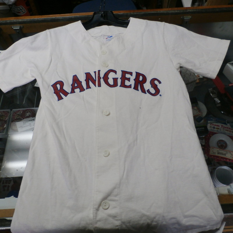"Texas Rangers YOUTH button-up shirt white size 10/12 100% cotton #22819<br /> Rating: (see below) 4- Fair Condition<br /> Team: Texas Rangers<br /> Player: Team<br /> Brand: Majestic<br /> Size: Boy's YOUTH 10/12-  (Measured Flat: chest 15"", length 24"")<br /> Color: white<br /> Style: short sleeve; screen printed; button up<br /> Material: 100% cotton<br /> Condition: 4- Fair Condition; wrinkled; some pilling and fuzz; material is stretched and worn from wearing and washing; some discoloration and fading; no rips or tears; material is dingy; dirt staining on front; pink and brown stains on right sleeve; small orange stains on left sleeve (see photos)<br /> Item #: 22819<br /> Shipping: FREE"