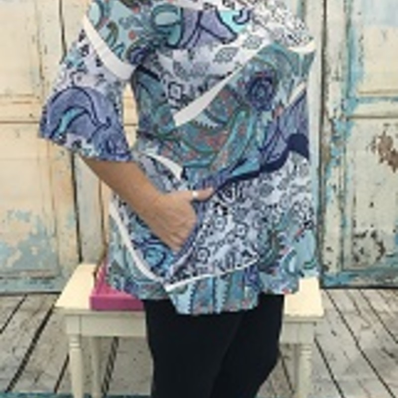 Multi Print Tunic<br /> with  Ruffle Sleeves &amp; Pockets<br /> 92% Polyester 8% Spandex<br /> 31&quot; length